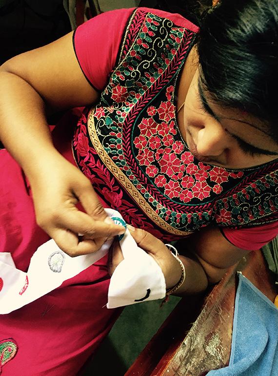 Gnadaa woman stitching
